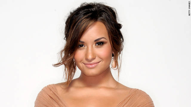 Demi Lovato addresses her issue with cutting on a ballad featured on her new album,