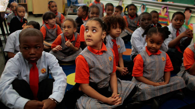 Students sit patiently at Harlem Success School, praised in the book