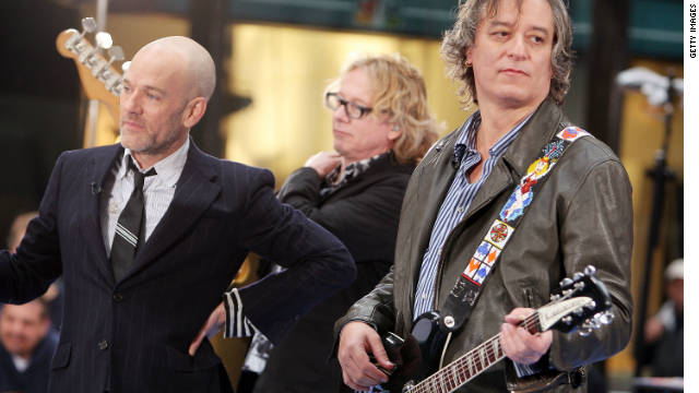 Michael Stipe, Mike Mills, and Peter Buck of R.E.M. perform on NBC's