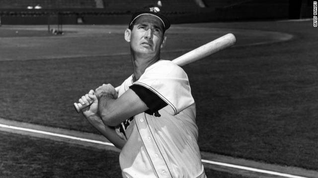 Ted Williams swings the bat in a photo taken circa 1955.