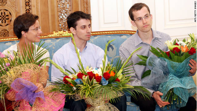 Josh Fattal, center, Shane Bauer and his fiancée Sarah Shourd wait Saturday in Oman before flying home.