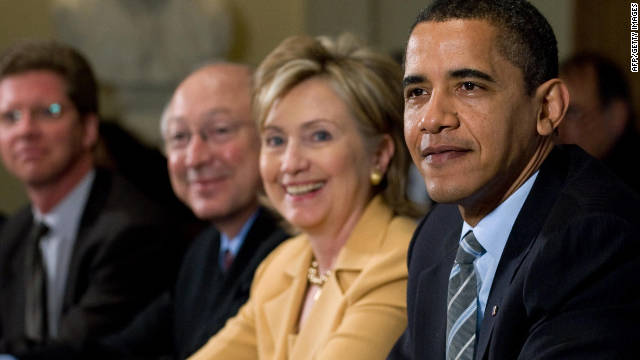 President Barack Obama sits beside Secretary of State Hillary Clinton during a Cabinet meeting in April 2009.