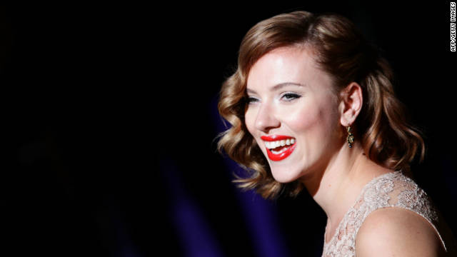 Actress Scarlett Johansson dazzled audiences with old Hollywood glamor at this year's Milan Fashion Week