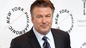 Greyhound wants Alec Baldwin to take a ride on one of its buses, saying there's no need to turn off electronic devices.