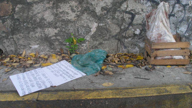 Five severed heads are placed in a sack and left on a suburban street in Acapulco, Mexico, on September 27, 2011.