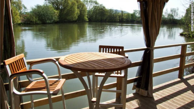 Outside, a wooden deck overlooks the lake.