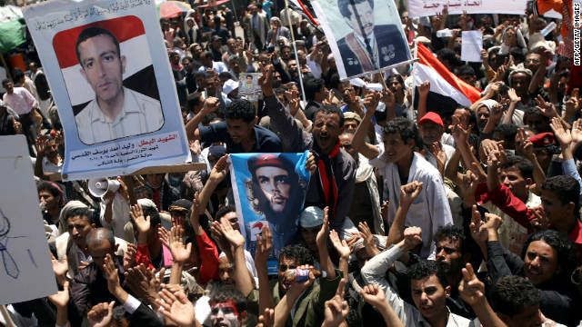 Yemeni opposition demonstrators shout slogans during an anti-regime protest in Sanaa on Wednesday.