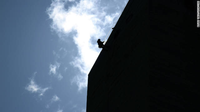 A worker descends the length of the monument after the earthquake. Officials say the heaviest damage seemed to be near the top of the structure.