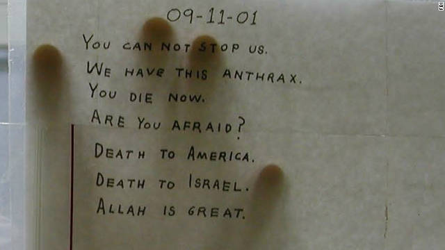 A scientist shows the anthrax-tainted letter sent to Sen. Tom Daschle's Capitol Hill office in fall 2001.