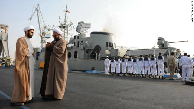 Iranian clerics in front of the Jamaran, Iran's first domestically built warship, during naval maneuvers in the Gulf in 2009.
