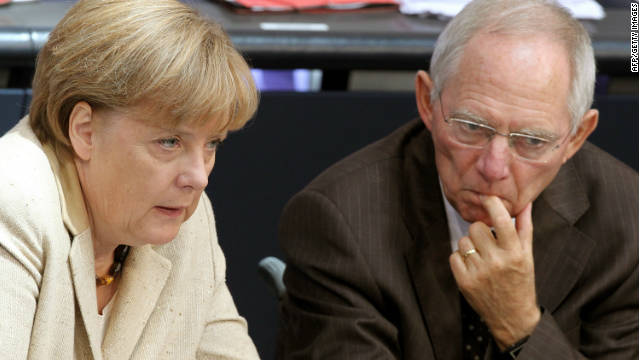 German Chancellor Angela Merkel, left, with Finance Minister Wolfgang Schauble at the lower house of parliament in Berlin.