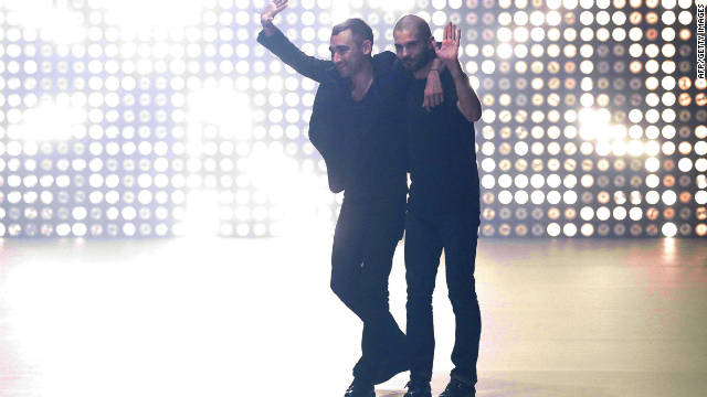 French designers Nicolas Formichetti and Sebastien Peigne acknowledge the crowd following the Thierry Mugler Spring/Summer 2012 ready-to-wear collection show.