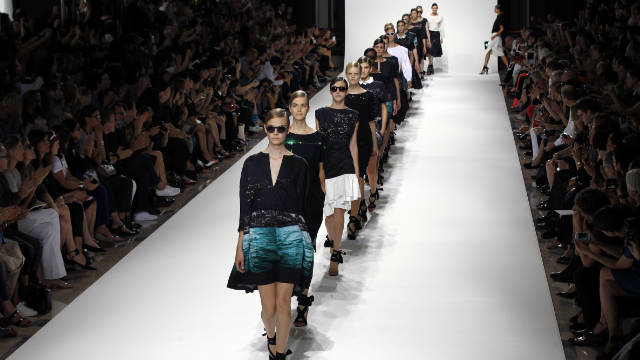 Models wear creations by Belgian designer Dries Van Noten during the Spring/Summer 2012 ready-to-wear collection show, on September 28.