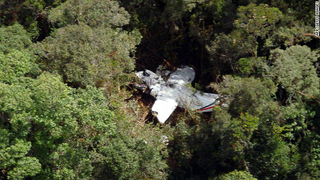 The wreckage of the airplane that crashed lies in among the trees at mount Hulusekelem in Bahorok, North Sumatra, on Friday.