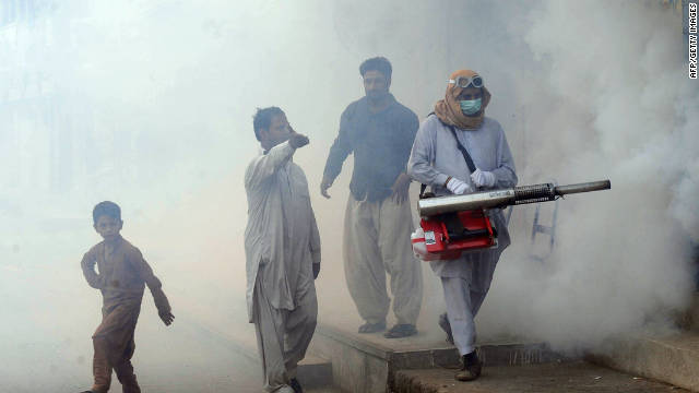 Pakistani health workers fumigate against dengue carrying mosquitos in the city of Lahore.