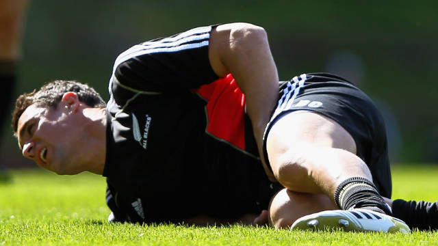 Ace goalkicker Dan Carter lies in pain after suffering an injury during training on Saturday.