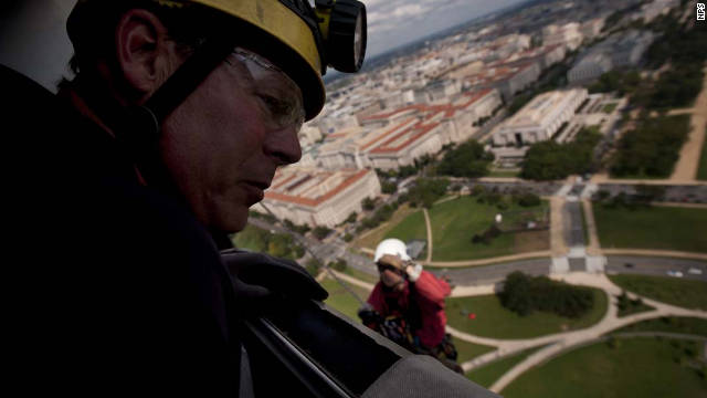 Dan Megerle looks out a window from the top of the Washington Monument on Friday, September 30, 2011, as part of the National Parks service inspection of the structure.