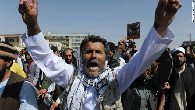 Supporters of Burhanuddin Rabbani shout slogans during a protest against the Taliban and Pakistan in Kabul on September 27.