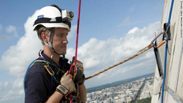 Climber Erik Sohn assesses damage to the Washington Monument on Friday.