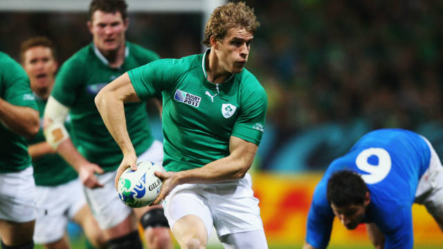 Andrew Trimble of Ireland, center, looks to pass during the Pool C match between Ireland and Italy.