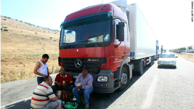 Truck drivers wait at the Cilvegozu border crossing between Turkey and Syria in June 2011.