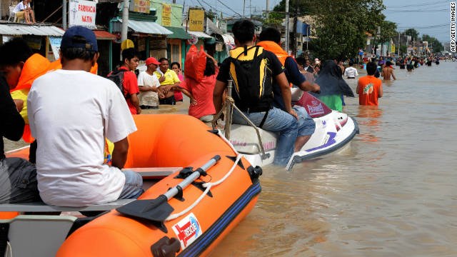 Residents of Calumpit have taken to using rafts and jet skies to travel down flooded streets
