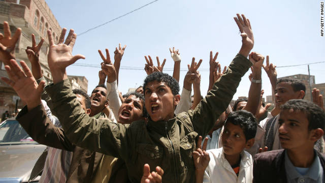 Yemeni anti-regime protesters chant slogans during a demonstration in Sanaa on October 2, 2011.