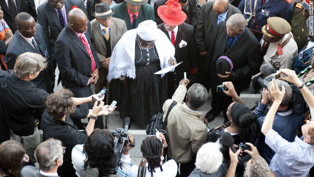 Members of the Namibian delegation read a prayer outside Berlin's Charite University Hospital before the ceremony.