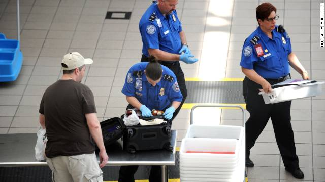 A TSA agent checks a bag on May 2, 2011, at Orlando International Airport.