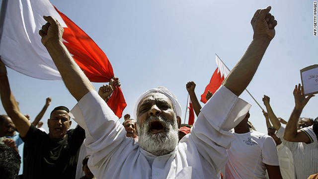 Bahraini Shiite mourners chant slogans during the funeral of a man killed during anti-government demonstrations in March. 