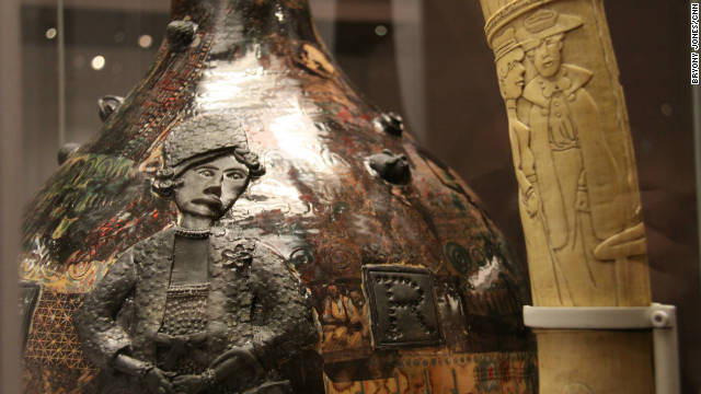 "Perry's ""I Have Never Been to Africa"" pot is shown alongside a carved tusk from the Democratic Republic of the Congo."