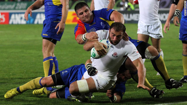 The Georgian team scores a try, and ultimately wins, during their pool match against Romania.