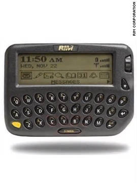 "The first BlackBerry phone was released by RIM Corporation in 1999. The phone was unusual at the time in that it had a full keyboard, could access e-mail and was used as a personal planner. It was the beginning of the always-connected era, prompting PC World in 2005 to name it the 15th greatest gadget of the past 50 years. It's now known as a ""CrackBerry"" by corporate executives across the world for its addictive qualities."