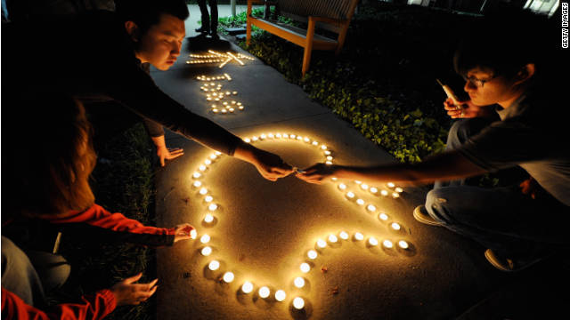 Chinese exchange students use candles to create a tribute to Steve Jobs at Apple's headquarters in California.