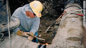 Pipeline welder Cody Pedigo works on a 2005 job in Farmington, New Mexico.