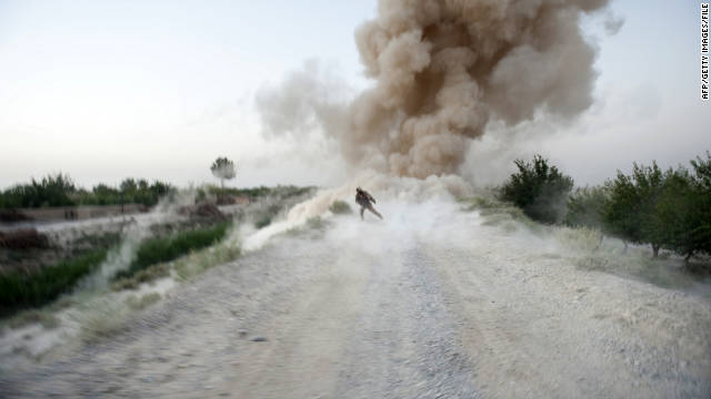 A U.S. Marine sergeant runs to safety as an IED explodes in Afghanistan's Helmand Province on July 13, 2009.