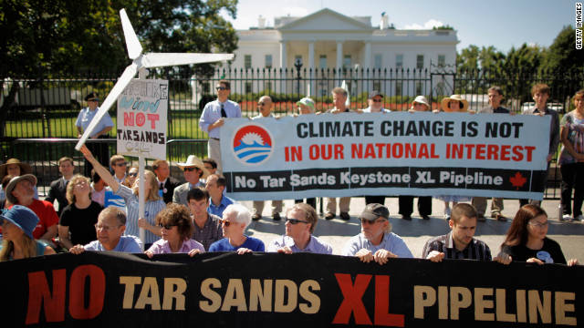 Demonstrators stage a White House sit-in protest in August calling on the president to block construction of an oil pipeline.