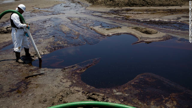 Crews clean up oil from the Deepwater Horizon disaster in Grand Isle, Louisiana, in June 2010.