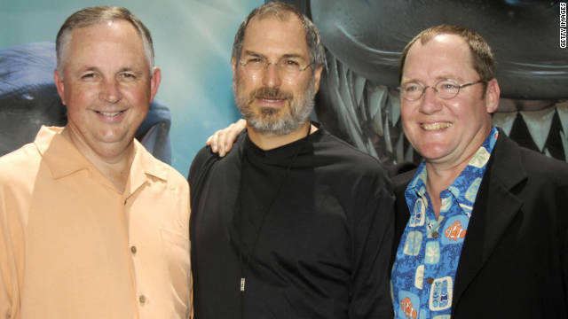 "Disney's Dick Cook, Jobs and producer John Lasseter pose for photographers at the premiere of ""Finding Nemo"" in Hollywood on May 18, 2003."