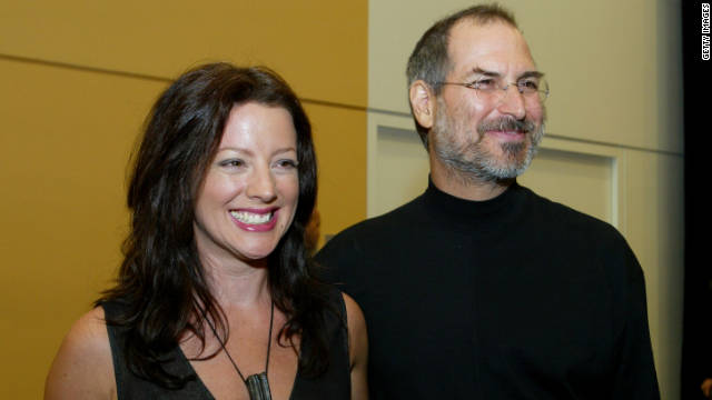 Jobs stands with singer Sarah McLachlan after delivering a speech in San Francisco in 2003.