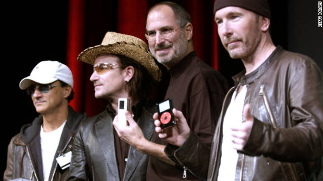 Jobs laughs with Jimmy Iovine, from left, Bono and The Edge of U2 at a celebration of the release of new iPod products in October 2004 in San Jose, California.