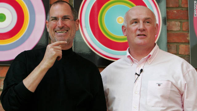 Jobs laughs as he poses with Eric Nicoli, chief executive officer of EMI, while promoting a new partnership in London in April 2007.