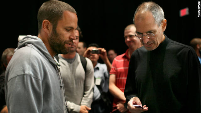 Musician Jack Johnson, left, talks with Jobs during an Apple special event in 2008 where a new version of the iPod Nano and Touch were announced.