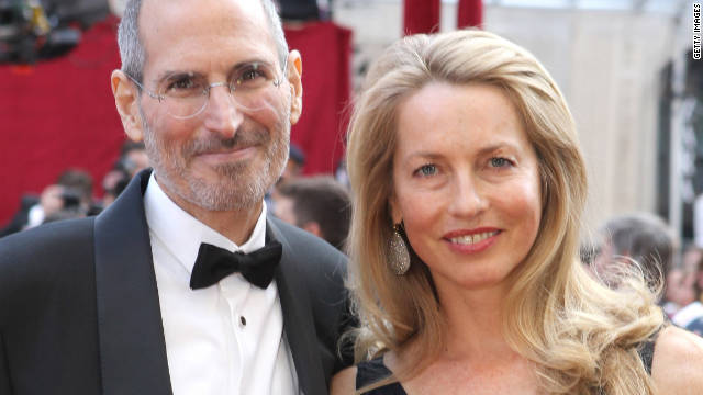 Jobs poses with his wife, Laurene Powell, at the 82nd annual Academy Awards on March 7, 2010, in Hollywood.