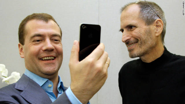 Russian President Dmitry Medvedev, left, admires his new iPhone 4 from Jobs on Medvedev's tour of Silicon Valley in June 2010.