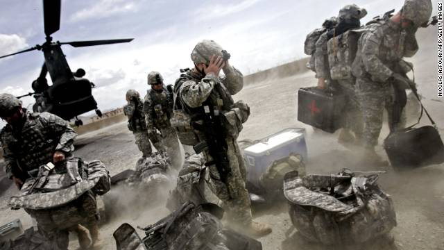 U.S. soldiers disembark from a Chinook helicopter in the Ghazni province of Afghanistan on May 28, 2007. President Bush called on NATO in February 2007 to increase troops in Afghanistan. There were already about 50,000 U.S. and NATO troops there.