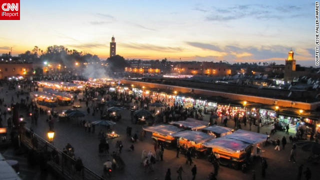 "Jessie Faller-Parrett snapped a shot of this view at dusk. ""The square in Marrakech is a fascinating spot, day or night, complete with food vendors, snake charmers and performers. Found a spot on a balcony, drank mint tea and watched the day-to-night transition for nearly four hours -- what a scene!"""