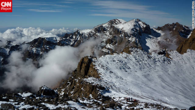 "David O'Neill took this photo of Jebel Toubkal, the highest mountain in Morocco and West Africa. This view ""demonstrates the progression along the lip of the basin with some other hikers in the foreground."""