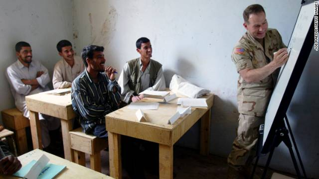 U.S. Army Lt. Col. Ed Dorman teaches an English class near the Bagram Air Base on April 20, 2002. As the base commander, Dorman decided to teach English to the local students to empower them to educate themselves.
