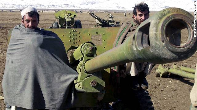 Afghan militiamen stand with a rocket launcher during a disarmament ceremony in Gardez on November 13, 2003. About 600 militiamen turned in their guns during the disarmament program.